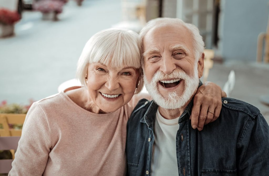 old couple sitting together and smiling