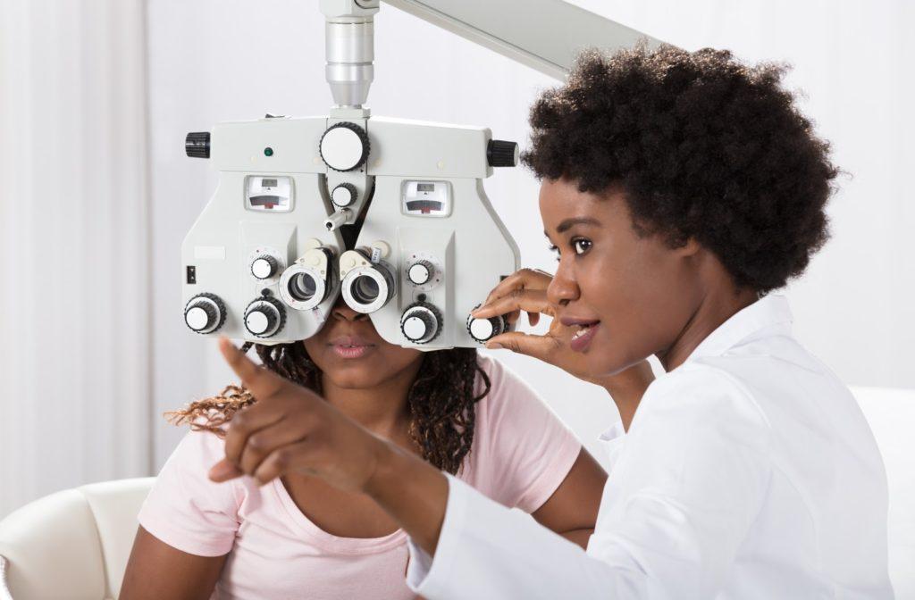 Optometrist performing and eye exam